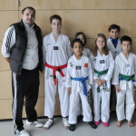TAE-KWON-DO Team mit Medaillen